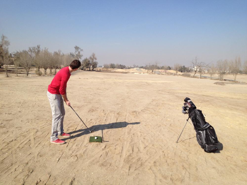 adam golfing